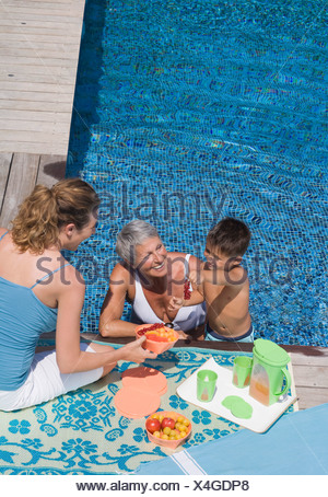Woman and boy in swimming pool - Stock Photo