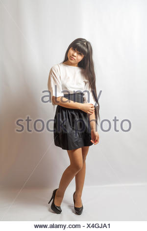Young woman black skirt. Portrait of asian woman. - Stock Photo