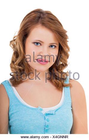 Blondes Mädchen Teenager mit blauen augen und blauem shirt lachend portrait isoliert - Stock Photo