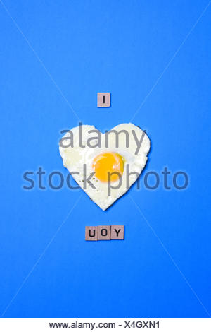 I love you written using an heart made with an egg - Stock Photo