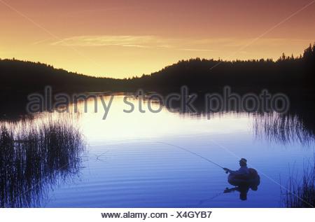 Fly-fishing at Lac Le Jeunne, Shuswap region, British Columbia, Canada. - Stock Photo