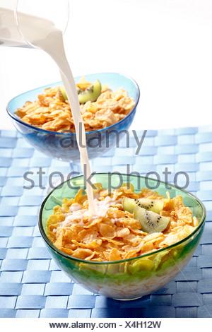 Cornflakes with kiwi, milk - Stock Photo