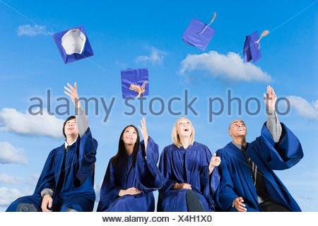 Graduating high school students - Stock Photo