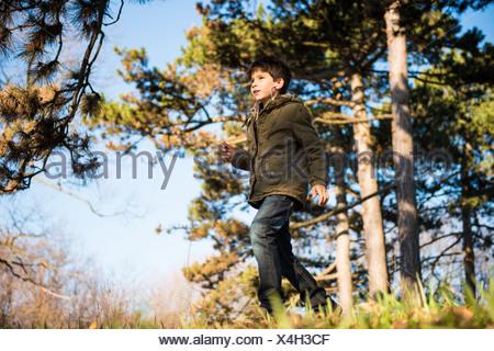 Boy walking in countryside - Stock Photo