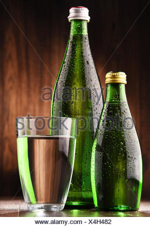 Composition with glass and bottles of mineral water. - Stock Photo