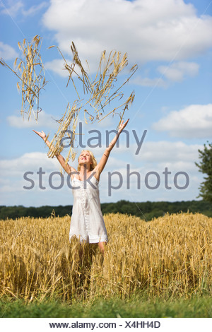 Young woman in a wheat field - Stock Photo