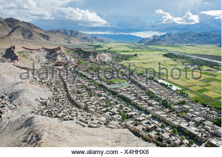 Tibetan Buddhism, aerial view, Palcho Monastery with the Kumbum Stupa behind the historic district, also known as Pelkor Chode - Stock Photo