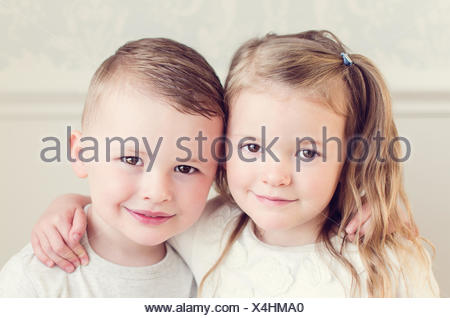 Girl and boy hugging each other - Stock Photo