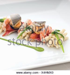 Close up of plate of Sardinian pasta - Stock Photo