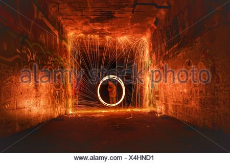 Another long exposure of steel wool spinning. - Stock Photo