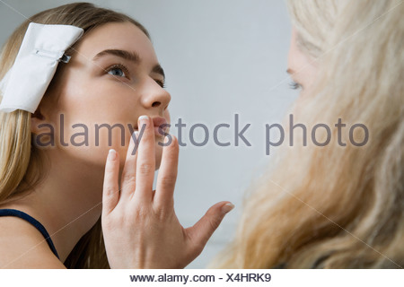 Makeup Artist Preparing Model - Stock Photo
