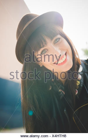 Happy young woman with nose rings - Stock Photo