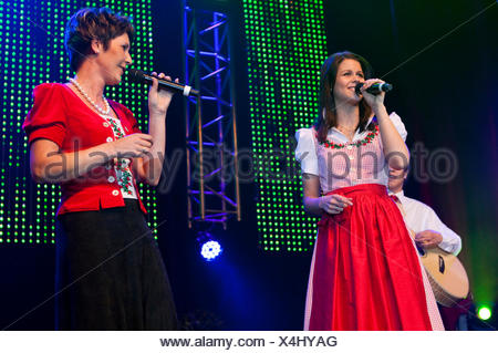 Swiss folk music and pop group Oesch's die Dritten performing live at the 10th Schlager-Night in the new Allmend Festival Hall - Stock Photo