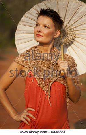 Portrait of Woman with Paper Umbrella - Stock Photo