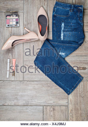 Flat lay photo of girl&#39 s jeans and accessories - Stock Photo