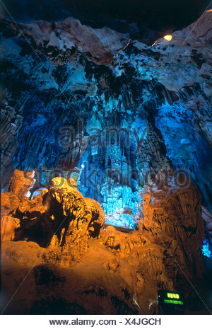 China, Guangxi, Guilin, Guangming Hill, Red Flute Cave,  illuminated hall in cave, stunning limestone formations in karst area - Stock Photo