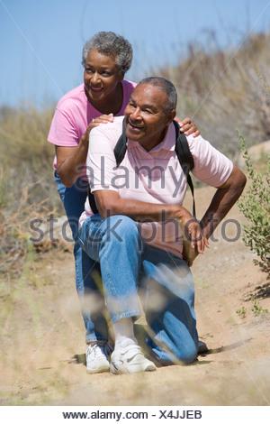 Senior couple on a walking trail - Stock Photo