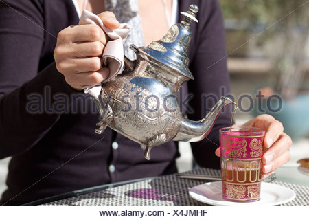 Pouring of tea in Morocco, Africa - Stock Photo
