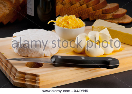 Close-up of assorted cheeses served with bread - Stock Photo