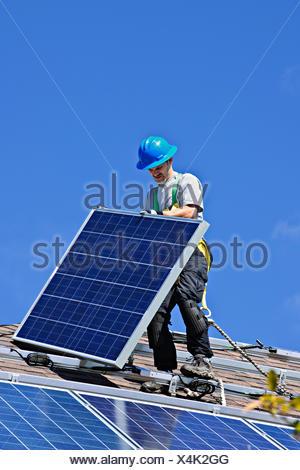craftsman,solar plant,installing - Stock Photo