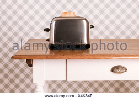 Old Kitchen Table Old kitchen table with toaster and slice of bread in front of stock old kitchen table with toaster and slice of bread in front of ornamental wallpaper studio workwithnaturefo