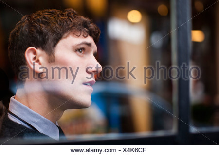 Businessman looking out window - Stock Photo