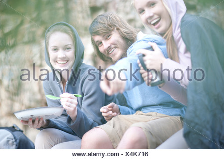 Young group of people eating and drinking outdoors - Stock Photo