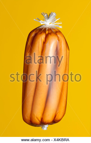 Conserved sausages in transparent plastic wrapping - Stock Photo