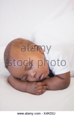 Baby boy sleeping peacefully on couch - Stock Photo