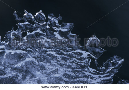 Ice pattern against black background - Stock Photo