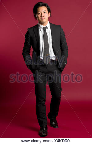 Walking Asian Male Portrait - Stock Photo