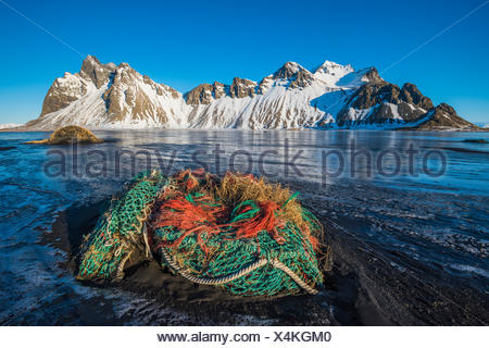 Stokksnes, Eastern Iceland, Europe. Fishing nets in front of Vestrahorn mountain in winter. - Stock Photo