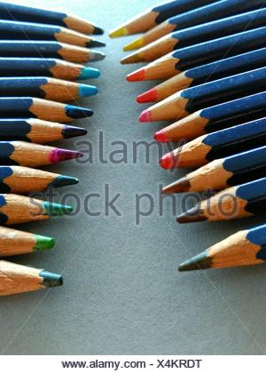 Colored Pencils In A Row On Table - Stock Photo