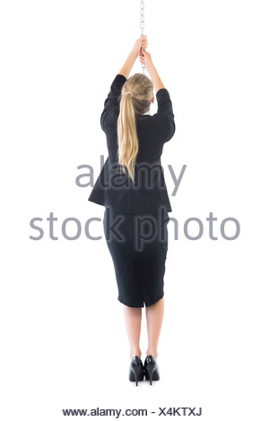 Pulling The Chain Awesome Rear View Of Blonde Businesswoman Pulling A Chain Stock Photo