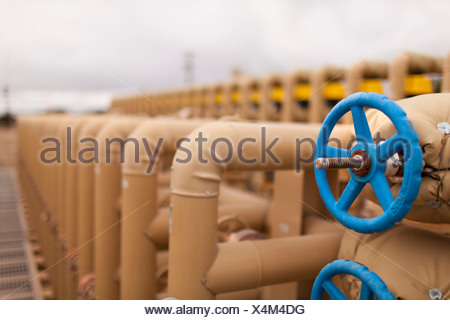 Fuel pipes in oil field, close up - Stock Photo