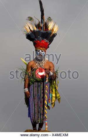Tribesman of the Western Highlands and his Bird of Paradise Headdress - Stock Photo
