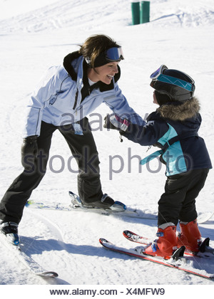 Woman and young girl skiing - Stock Photo