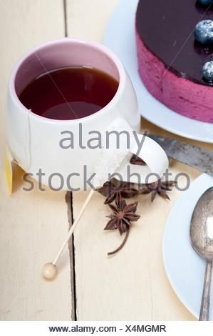 english black tea and berries dessert close up. - Stock Photo