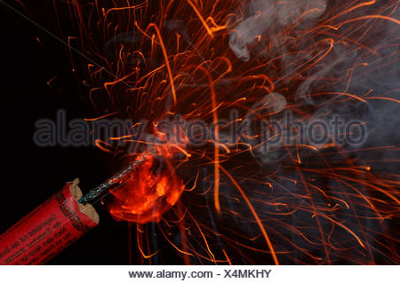 fire conflagration silvester bang saluting gun clacker slow match firework - Stock Photo
