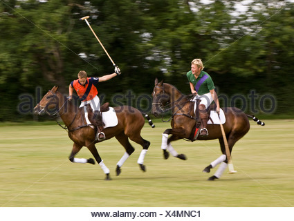 Two polo players in rivalry for the ball - Stock Photo