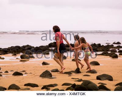 Walking along a beach in Kauai, Hawaii, USA - Stock Photo