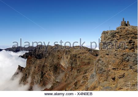 Summit of the Pico Fuente Nueva with a sea of clouds in the Caldera de Taburiente National Park, La Palma, Canary Islands, Spain - Stock Photo
