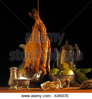 Kippers hanging above a table - Stock Photo