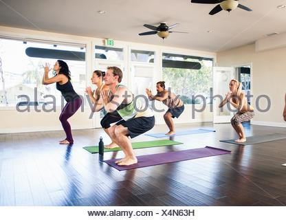 Five people in yoga class - Stock Photo