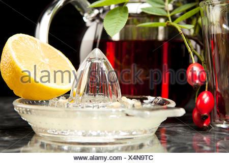 Hagebuttentee mit Zitrone im Glas - Stock Photo