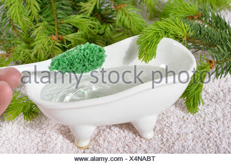 Foam bath with spruce concentrate - Stock Photo