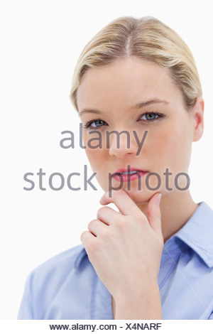 Thoughtful woman touching her chin - Stock Photo