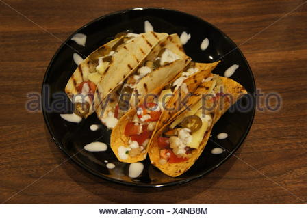 High Angle View Of Fish Taco In Plate On Wooden Table - Stock Photo
