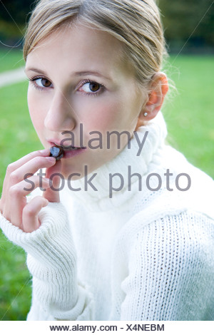 young woman taking medicines - Stock Photo