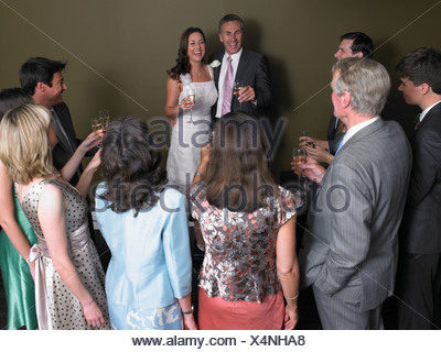 Wedding guests toasting the bride and groom - Stock Photo
